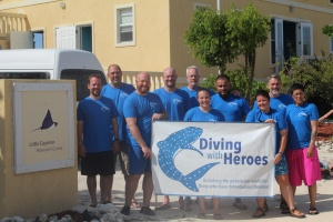 The Diving with Heroes group, from left, hero diver Aaron Kirzner, hero diver Rob Howland, volunteer diver Matt Staton, hero diver Ken Shere, volunteer diver Scott Vadnais, hero diver Brenda Hawkes, hero diver Sergio Trejo, volunteer diver Jill Hottel, volunteer diver Joe Brickey and hero diver Dani Figueroa, at the Central Caribbean Marine Institute's facility on Little Cayman Island.