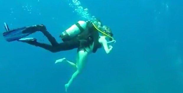 Scuba Diver Piggy Backs Tourist